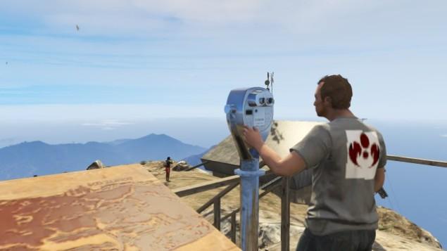 ricky peering into a telescope