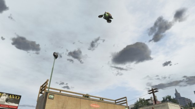 airing out a motorcycle off a vert ramp